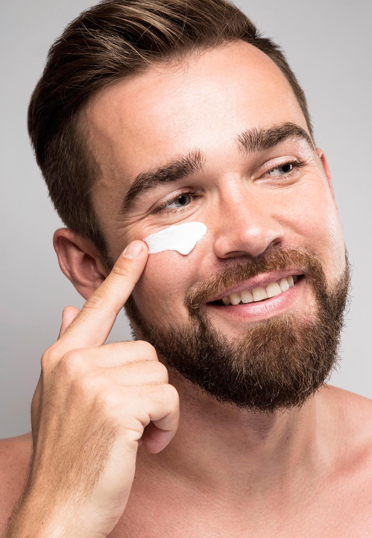 man-using-face-cream